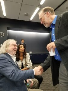 James Allison shaking hands with Fred Ramsdell of Parker Institute after winning the Nobel Prize